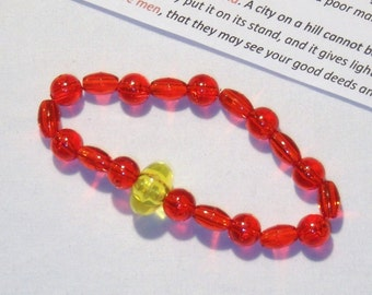 CONFORMITY BRACELET, DO NOT CONFORM TO THIS WORLD, bracelet, red beads with one yellow  bead, be different