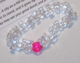 CONFORMITY BRACELET, DO NOT CONFORM TO THIS WORLD, bracelet, clear beads with one hot pink bead, be different