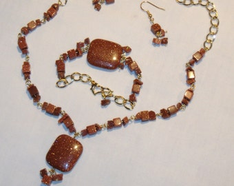 GOLDSTONE JEWELRY SET, necklace with pendant, bracelet, dangle earrings, gold