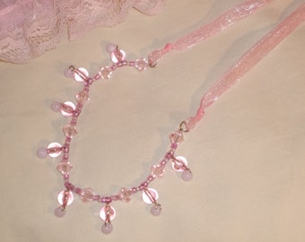 Pretty in pink necklace has ribbon, beads and ribbon, adjustable length
