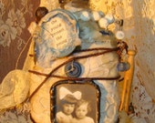 The Young Protect the Young, mixed media bottle art assemblage