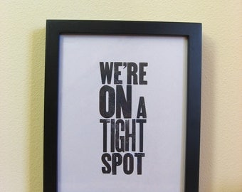 Letterpress Art Print: We're ON a Tight Spot, Black Antique Wood Type on Newsprint.