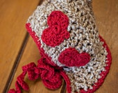 Tan Pixie Bonnet with Red Hearts and Curly Ties