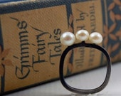 Oxidized Silver Ring with 3 white pearls by Markhed