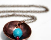 Copper bowl and turquoise necklace