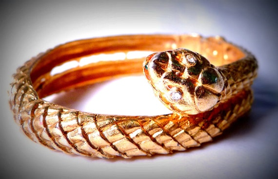 Gold tone Snake Clamper Bracelet with Rhinestone Accents