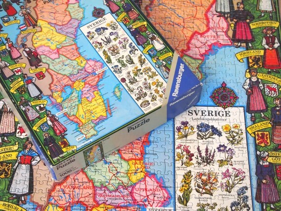 Vintage 1976 Sverige Map Puzzle of Sweden by Ravensburger featuring traditional folk costumes of each folk group, emblem, wildflowers