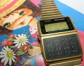 Traveling with my vintage calculator data bank watch, CASIO in Gold - summerground