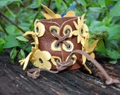 Recycled Leather cuff, yellow on brown