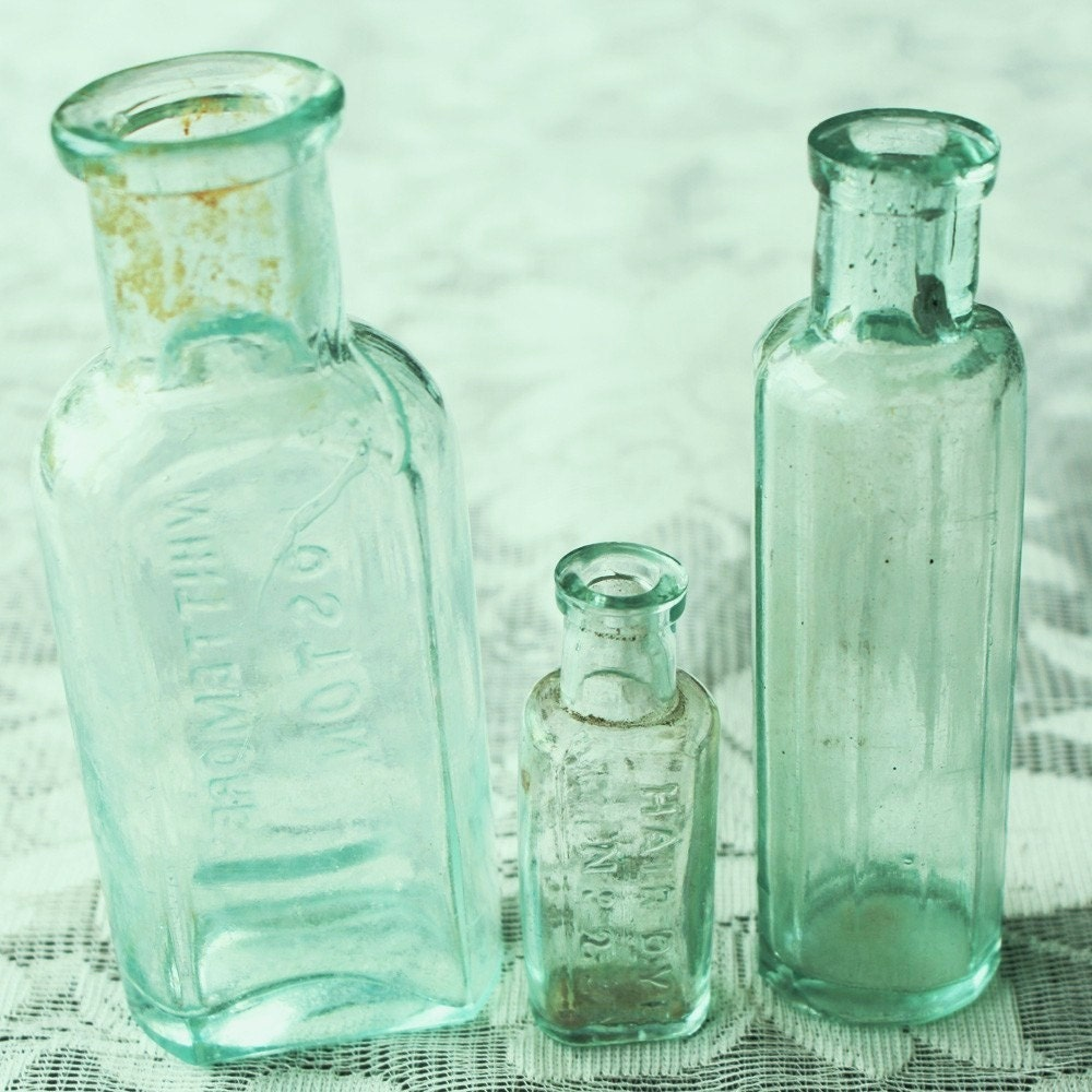 Three Antique Aqua Colored Glass Bottles From The Late