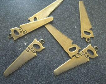 Brass Saw Charms (4)