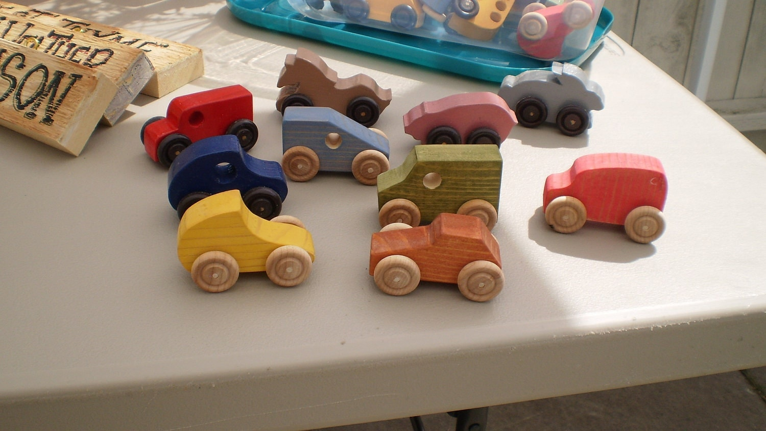 asst small toy wood cars and some animals on wheels by dsal965