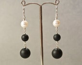 Matte black onyx, white freshwater pearl and sterling silver dangly earrings