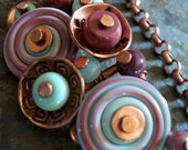 Button Necklace Light Blue and Berry Lampwork Swirls in Antiqued Copper