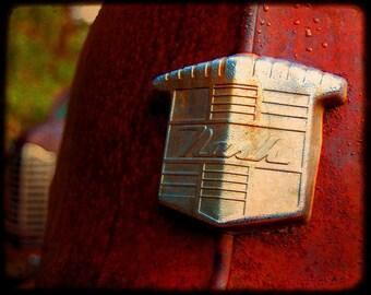 Mr. Newman's Emblem - Rusty Old Car - Nash - Fine Art Photograph by Kelly Warren