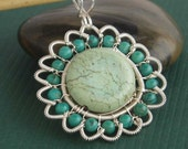 Sunflower sterling silver necklace with  wire wrapped pendant, blue green color.