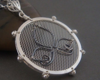 Macaron Sterling silver necklace with wire wrapped silver pendant. Sterling silver jewelry