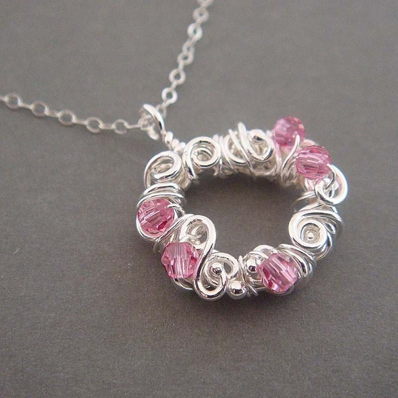 Silver wreath, sterling silver necklace with silver and pink wire wrapped circle pendant. Sterling silver jewelry