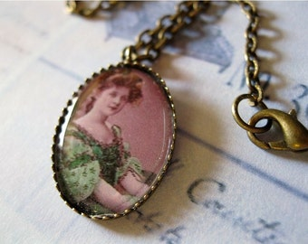 Irish Maiden necklace - Image set in  brass encased beneath acrylic dome, 18 inch chain,