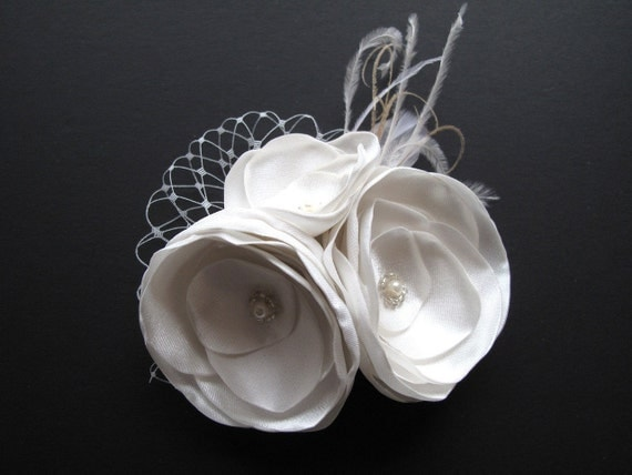White or ivory satin flower cluster fascinator with french netting accents and feathers