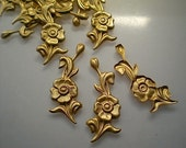12 brass floral charms