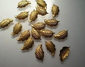 18 tiny brass leaf charms, No. 2