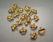18 tiny brass crown charms