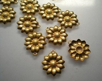 12 small brass flower charms
