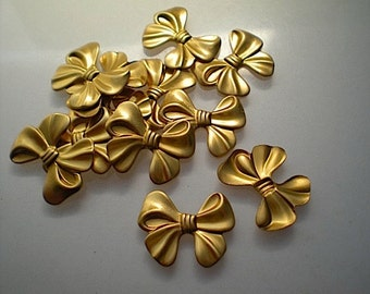 12 small brass bow charms