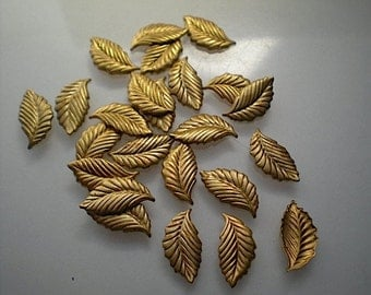 24 tiny brass leaf charms