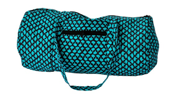 Quilted Duffle bag in black with aqua blue print.
