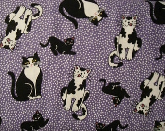 Purple cotton fabric with white dots and black and white cats