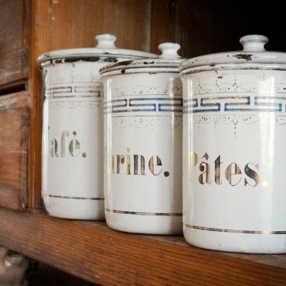 vintage French enamelware tins, set of 4 canisters, white with dainty gold and blue pattern and serif type