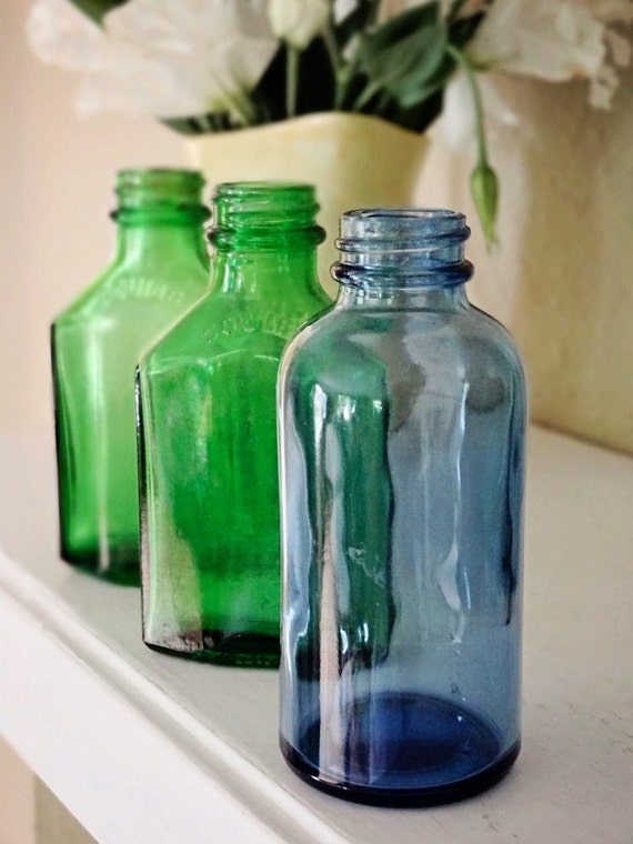 vintage glass bottles, set of 3, green glass Squibb and blue glass round