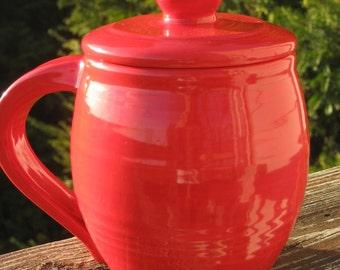 large covered mug, red
