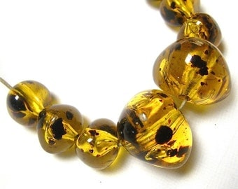 Resin Beads with Floating Dark Specks in Amber (8)