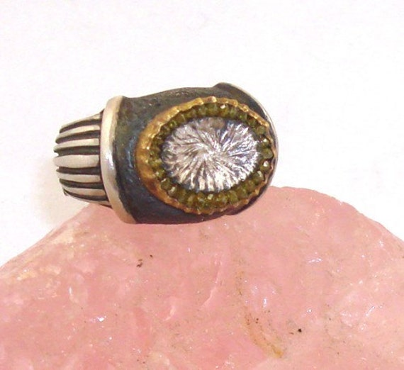 Sterling silver ring with 22k gold and diamonds made in just your size.