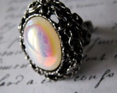 Ornate white opal snow queen ring in silver