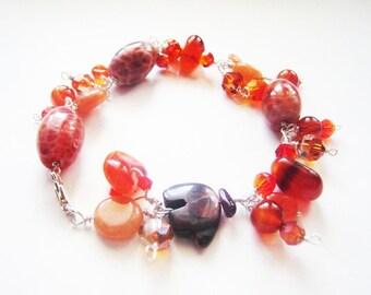 Bear bracelet.  Carnelian bracelet.  Crystal bracelet.  Brown bracelet.  Sterling silver.  Wire wrapped.
