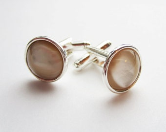 Ivory cuff links.  Shell cuff links.  Mother of pearl silver bezel set cuff links for French cuffs