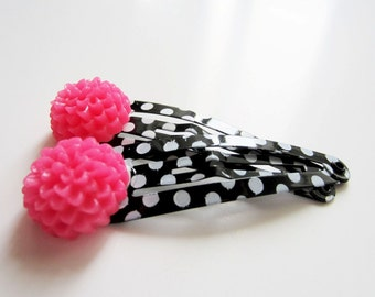 Snap hair clips.  Hot pink flower on black and white polka dot clippies