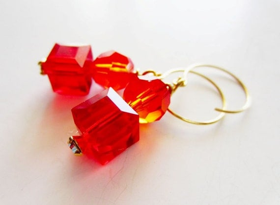 Fiery orange red crystal and gold dangle earrings