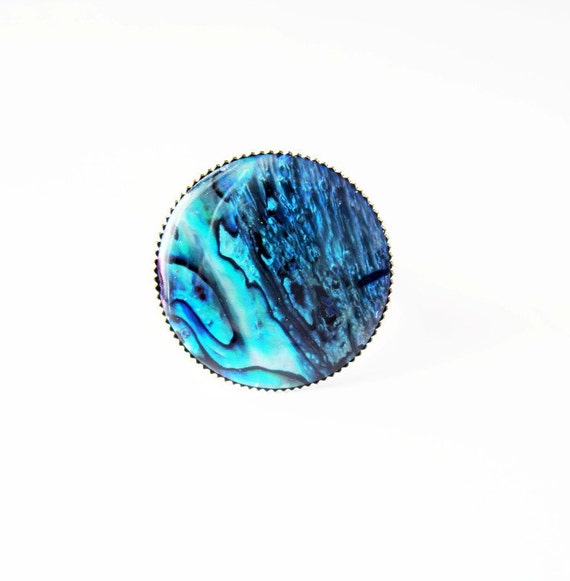 Round blue green paua shell ring in shiny silver adjustable crown setting