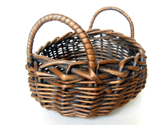 Vintage wicker basket. Oval shaped with handles. Country, cottage, garden, more.