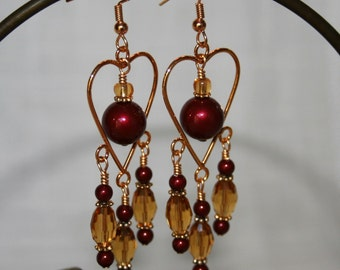 Gold plated earring with Swarovski pearls and celestial crystal pewter
