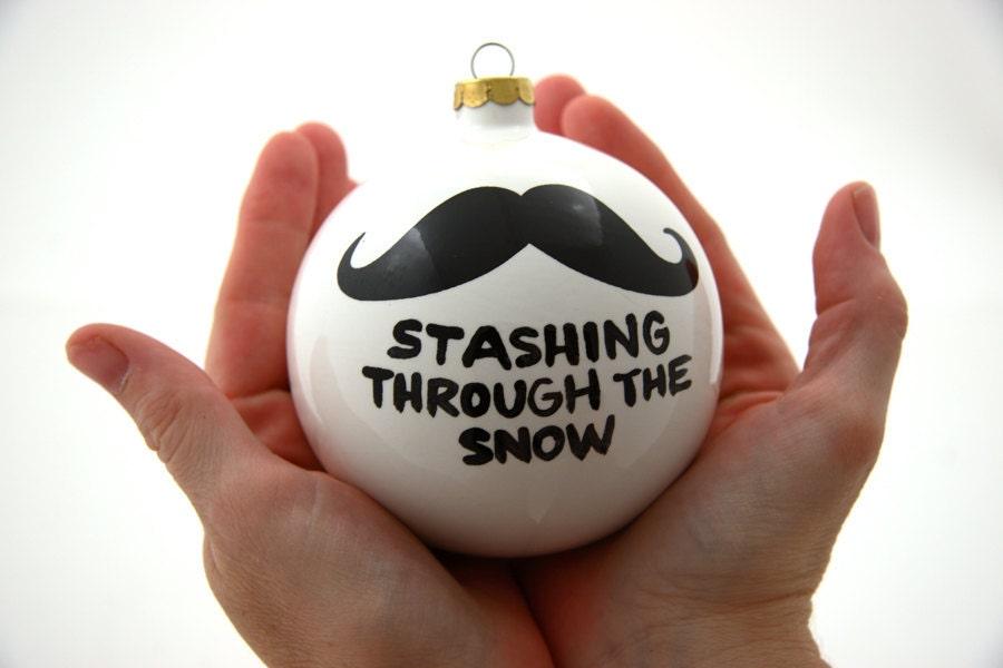Christmas ornament stashing through the snow ceramic ball for Funny christmas decorations