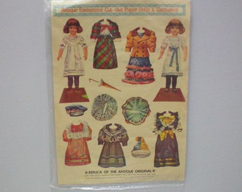 Antique Paper Dolls Embossed