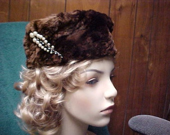 Brown fur woman's hat with vintage Rhinestone and faux pearl pin attached