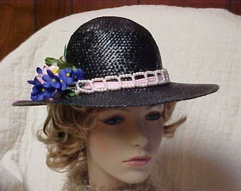 Lovely black straw wide brim womans  hat with faux pearl band and flowers.  Fits 21-22 in