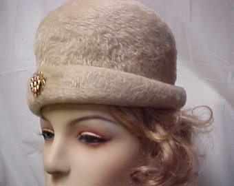 Imported beige fur cloche hat with rhinestone brooch by Duches-made in Italy- size 22 inches
